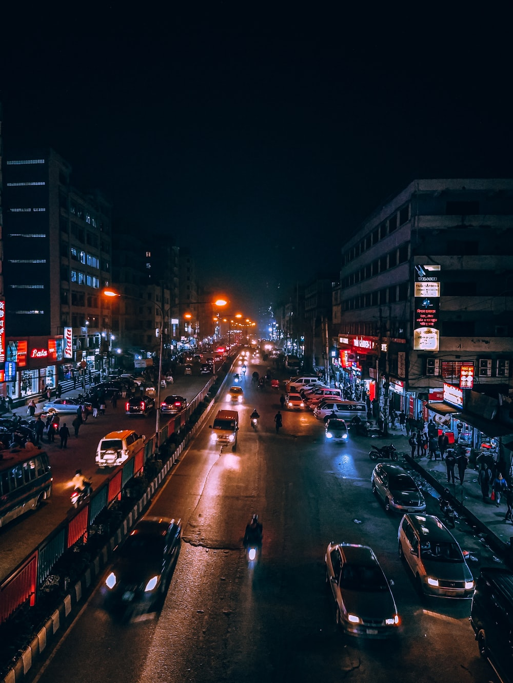 cars parked on side of the road during night time