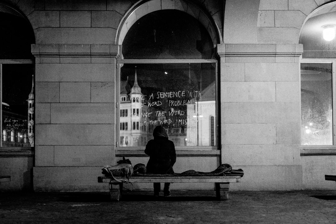 Man Sitting On Bench In Front of Glass Window - unsplash