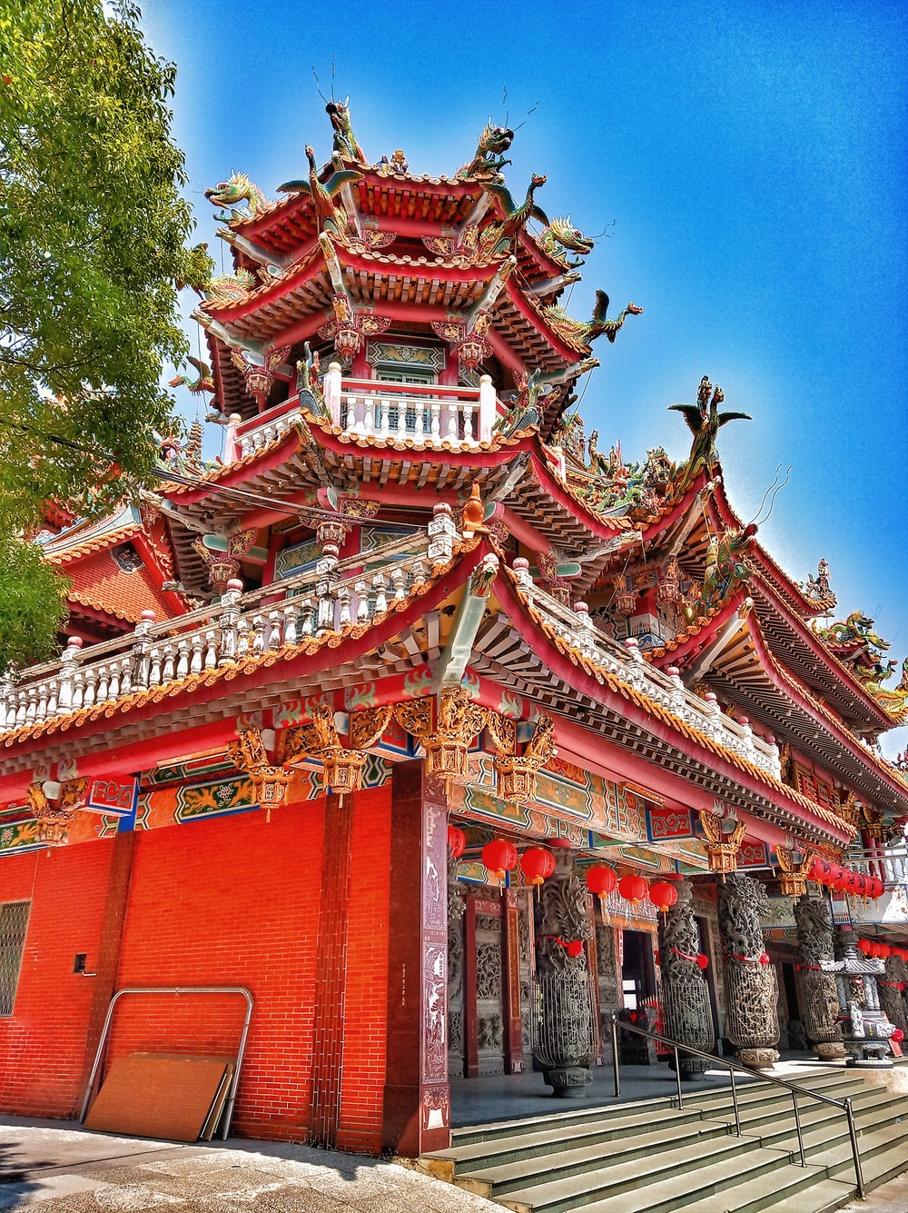 red and white temple under blue sky during daytime