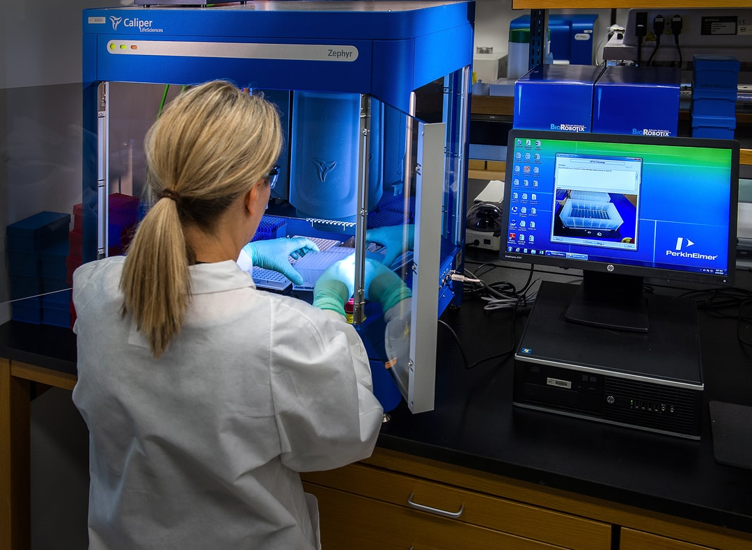 This image depicted a Centers for Disease Control and Prevention (CDC) scientist interacting with her Caliper LifeSciences' Zephyr Molecular Biology Workstation, working with samples to be tested using a real-time PCR machine, known as a themocycler (see PHIL 22904), in order to identify the various types of poliovirus contained therein. The data from this analysis is stored in a computer, while the software further analyzes the data before being reviewed by a scientist.