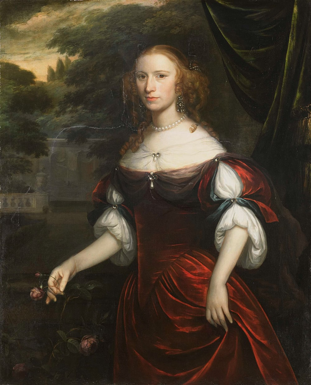 woman in red and black dress painting