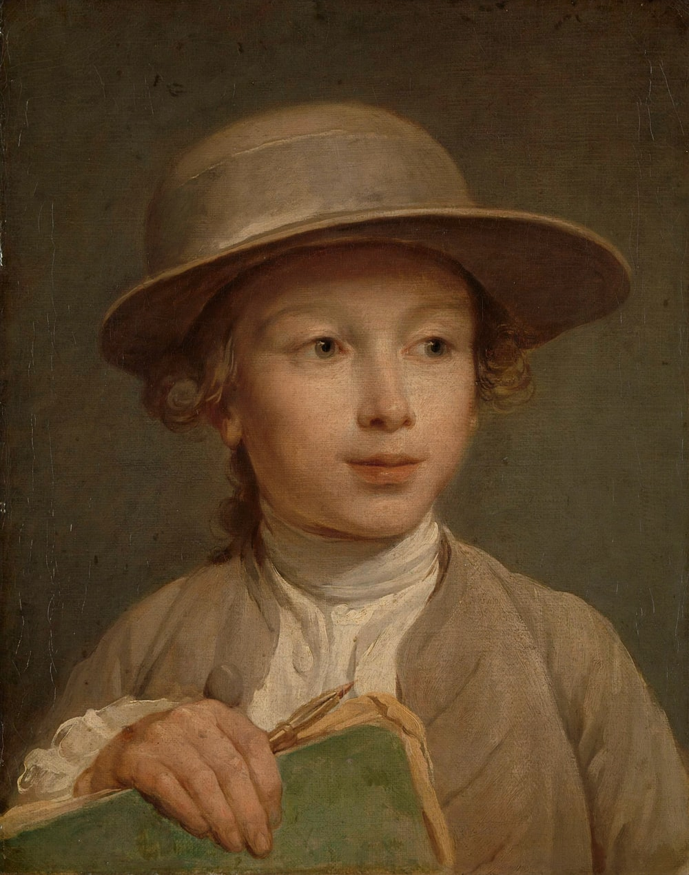 boy in brown hat painting