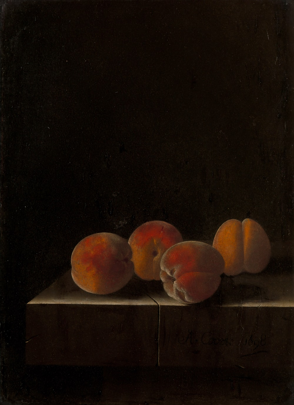 orange fruits on white wooden table