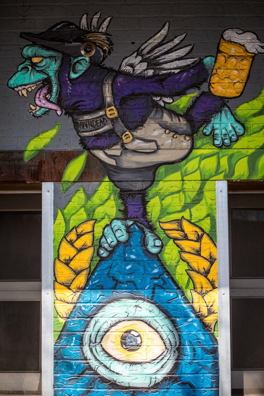 purple and yellow dragon wall art