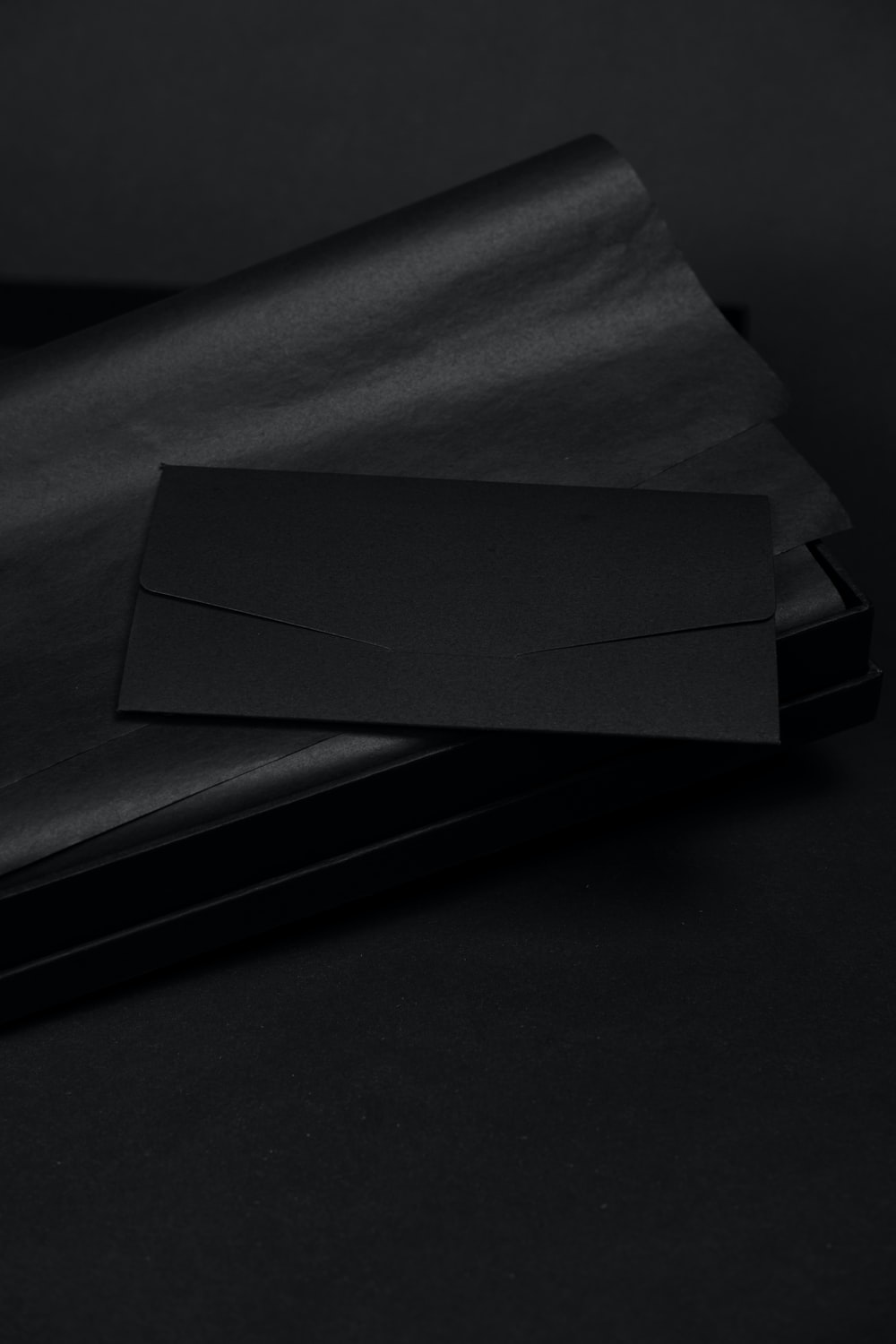 white paper on black surface