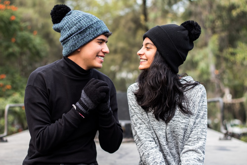 woman in black and gray knit cap and gray sweater