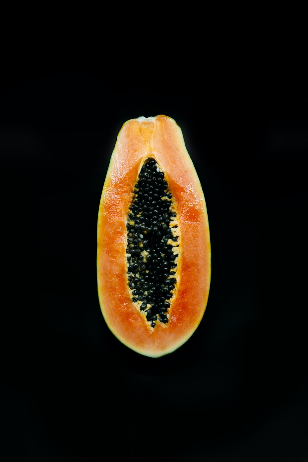 sliced tomato with black background