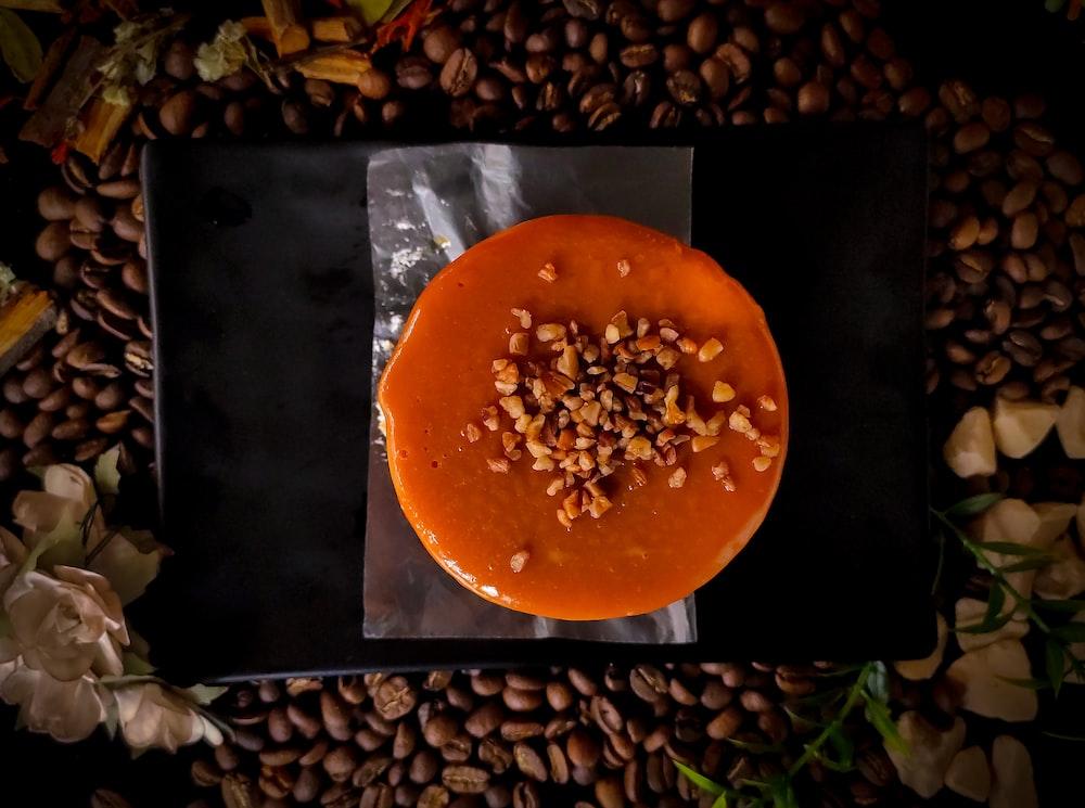 orange round fruit on black surface
