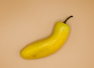 yellow banana on white table