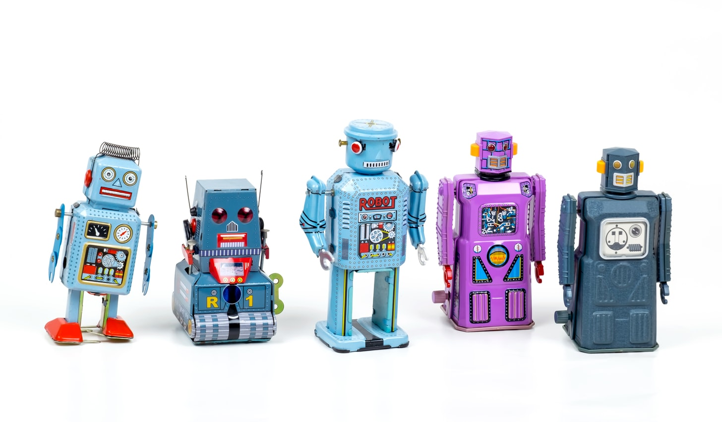 Five colourful robots stand in a line.