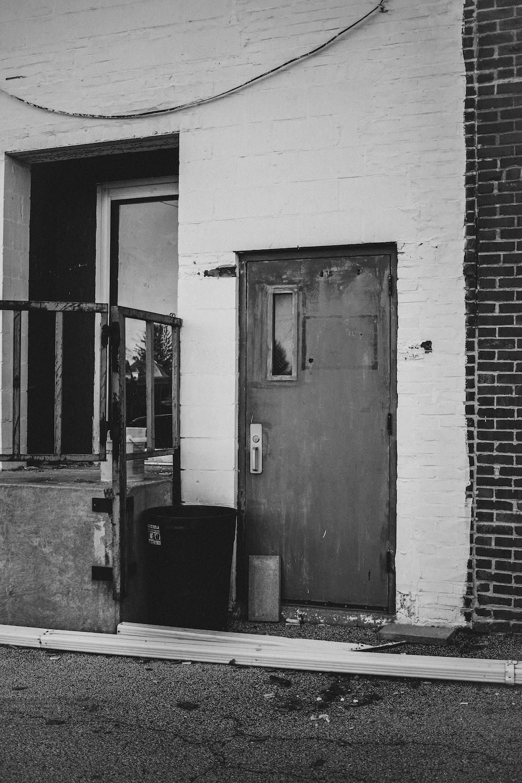 grayscale photo of closed door