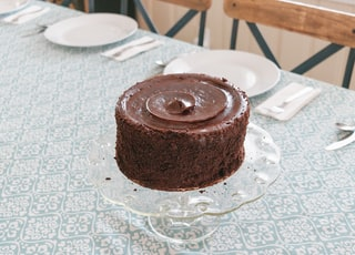 chocolate cake on white table cloth