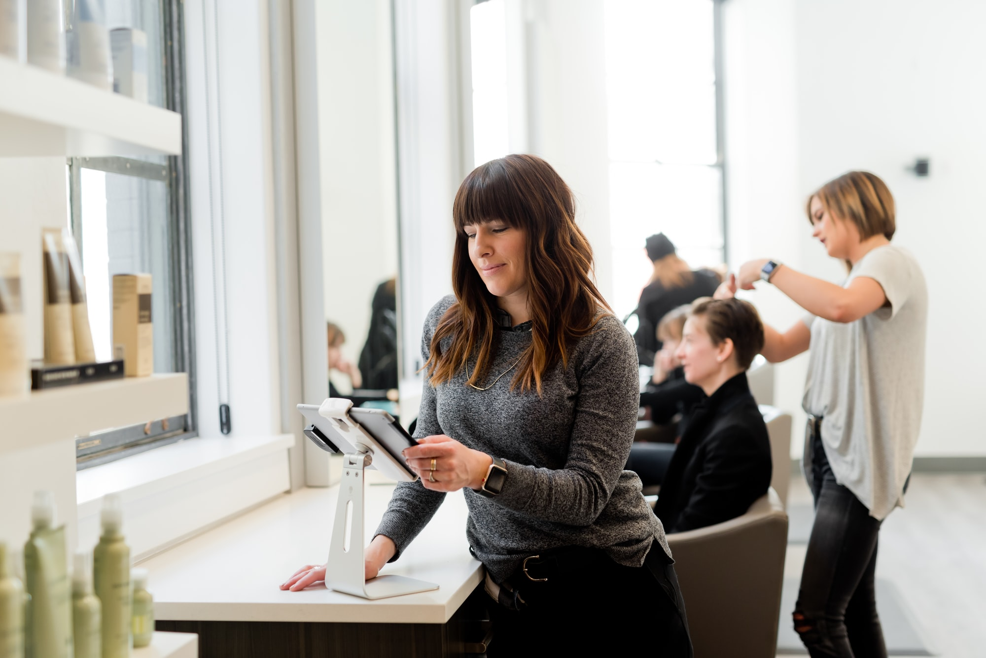 Woman looking at tablet in a salon. Business owner, female entrepreneur.    Kulør Hair Design and Color Studio is the best place for hair styling, located at 22 East Center Street in Logan, Utah.  https://www.instagram.com/kulorsalon/ https://www.kulorsalon.com/ 435-213-9075 https://www.aveda.com/salon/KulorSalon  https://www.instagram.com/AwCreativeUT/ https://www.AwCreativeUT.com/ #AwCreativeUT #awcreative #AdamWinger