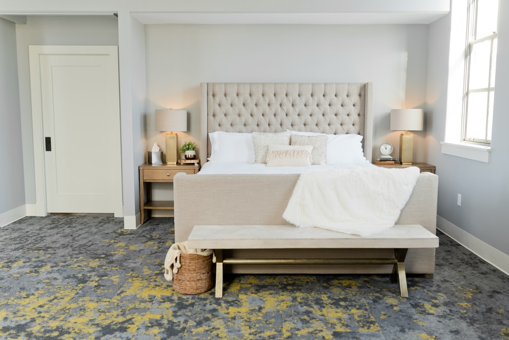 white bed linen on brown wooden bed frame