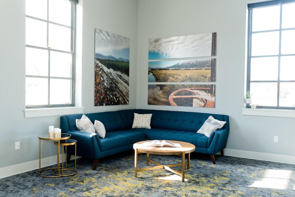 blue and white sofa near window