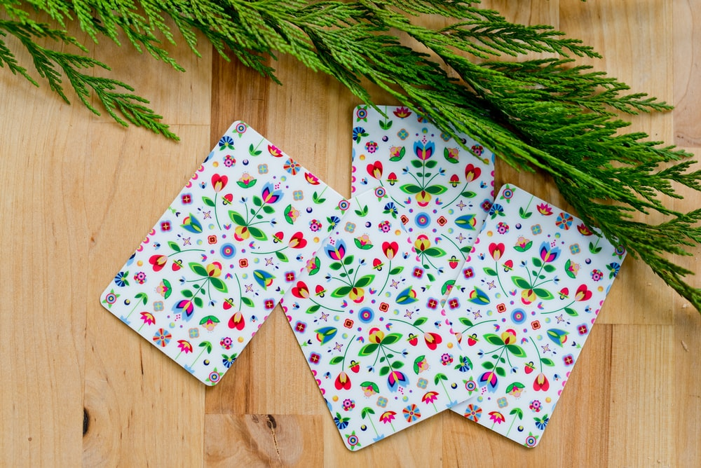 white red and green floral textile