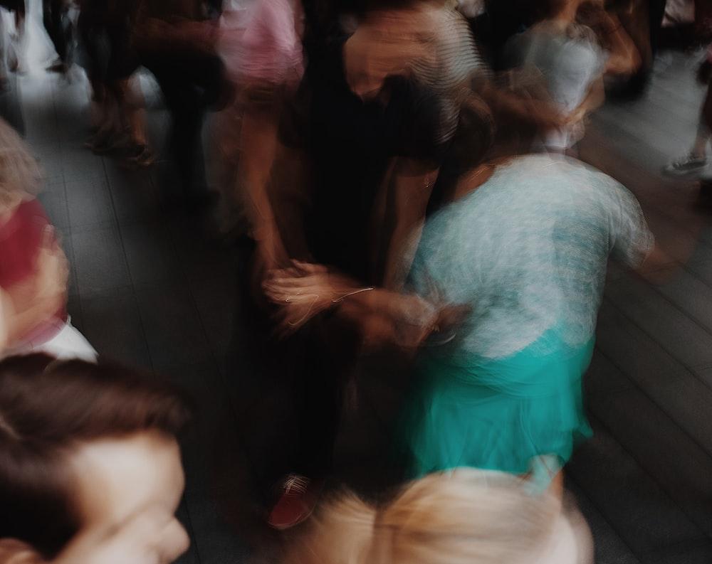 people standing on gray floor tiles