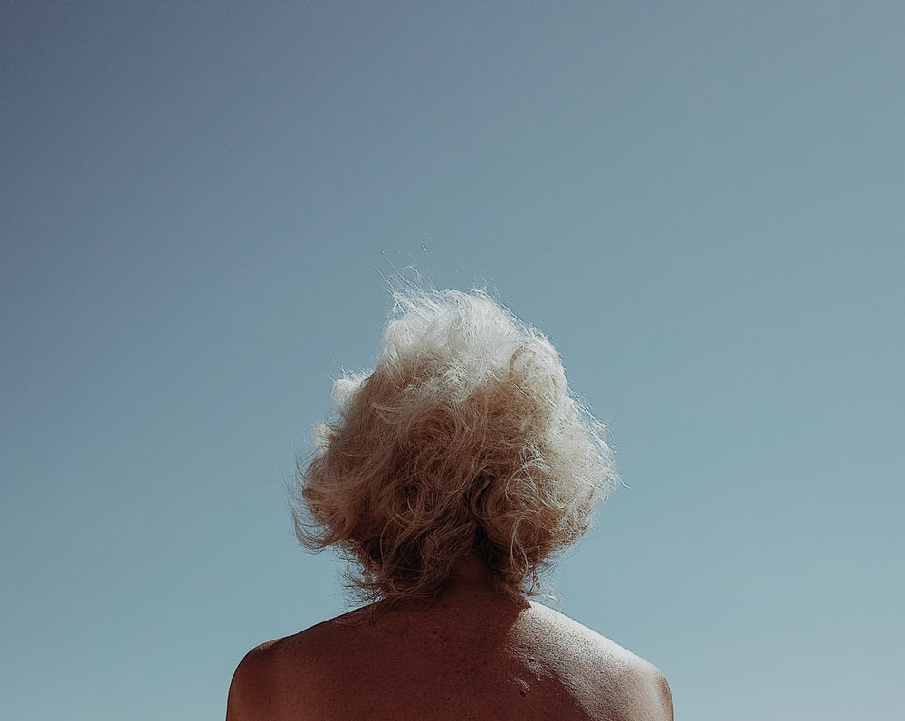 woman with white curly hair