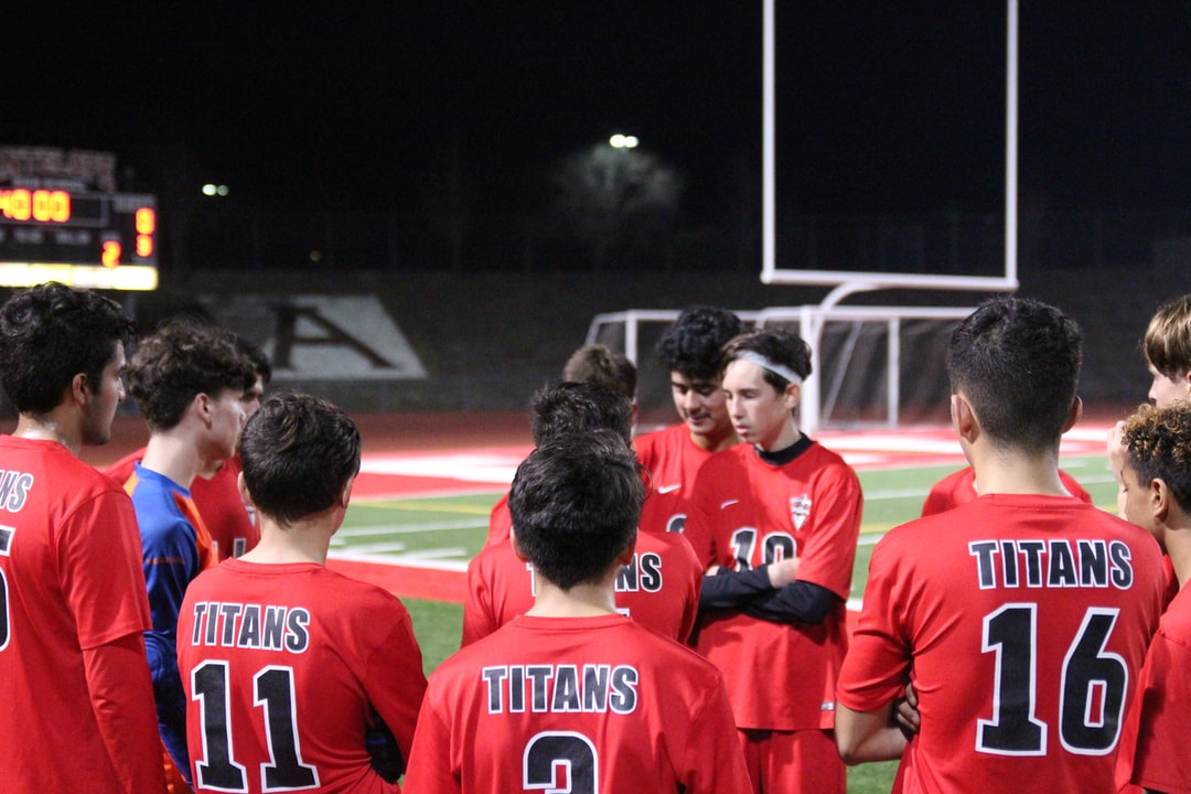 Soccer team talks about mistakes made in first half of the soccer game.