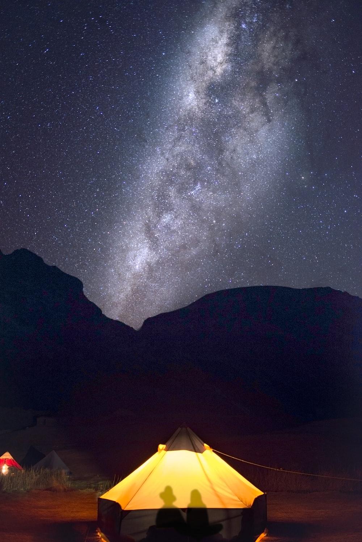 brown tent under starry night