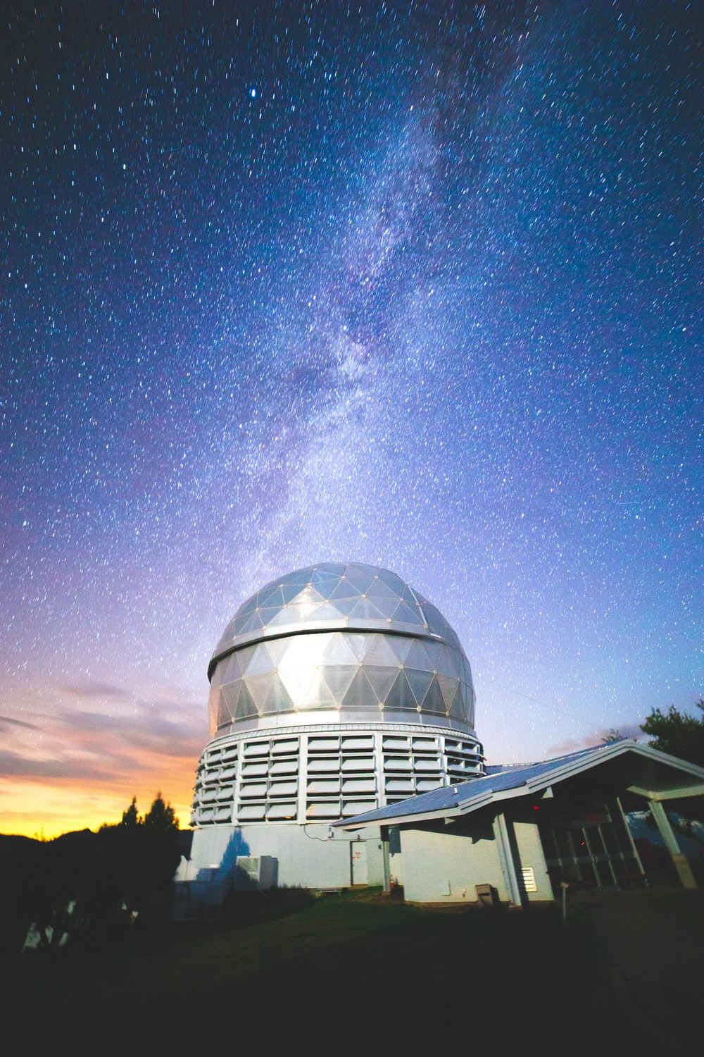 white dome building under starry night