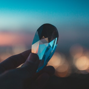 person holding heart shaped glass