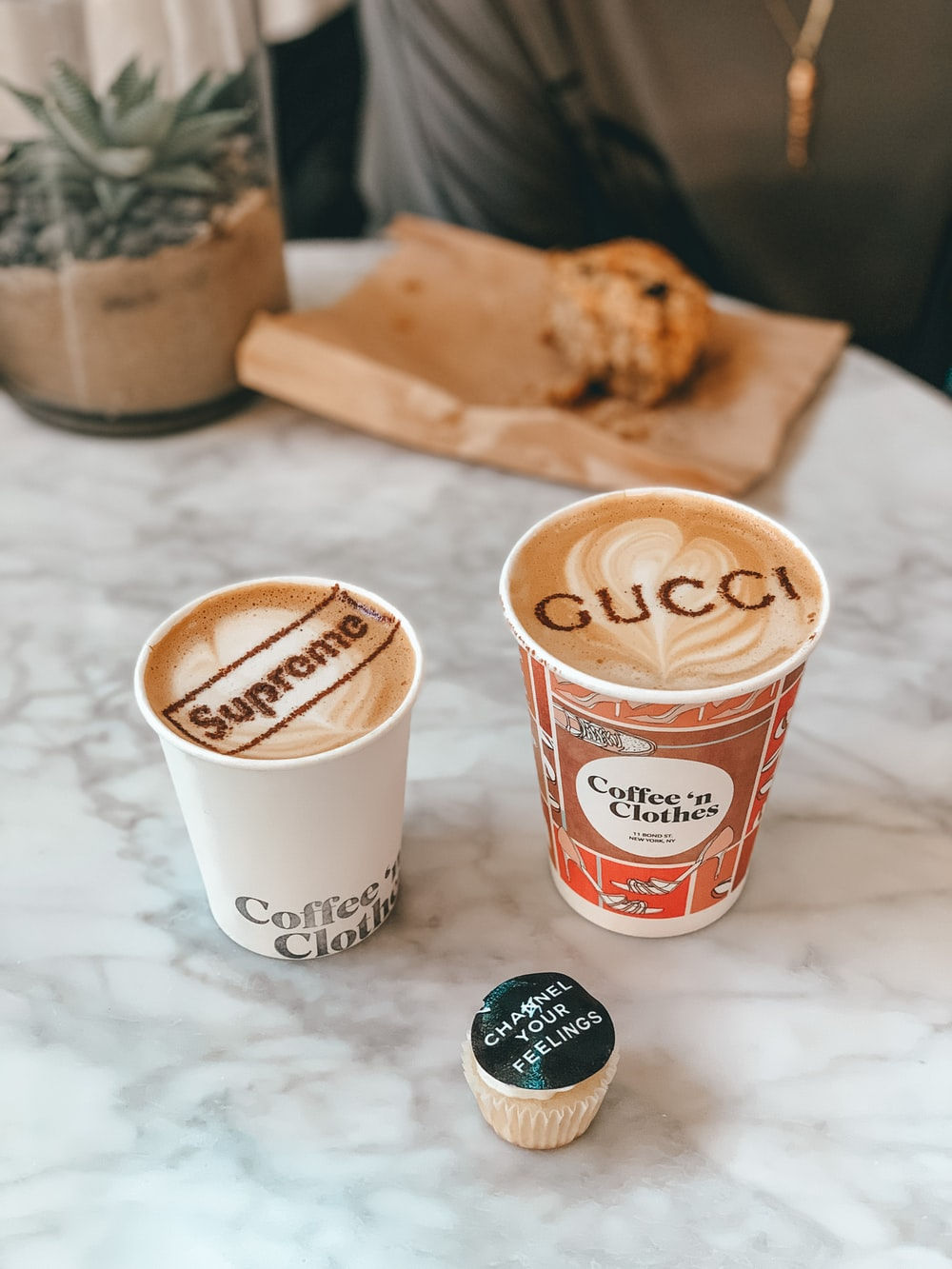 white and red disposable cup beside brown bread
