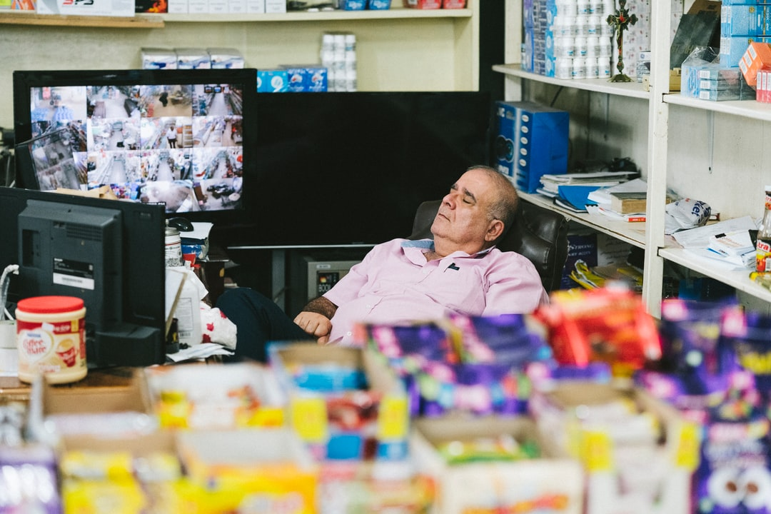 A Store Owner Sleeping and Not Watching the Security Cameras.  - unsplash