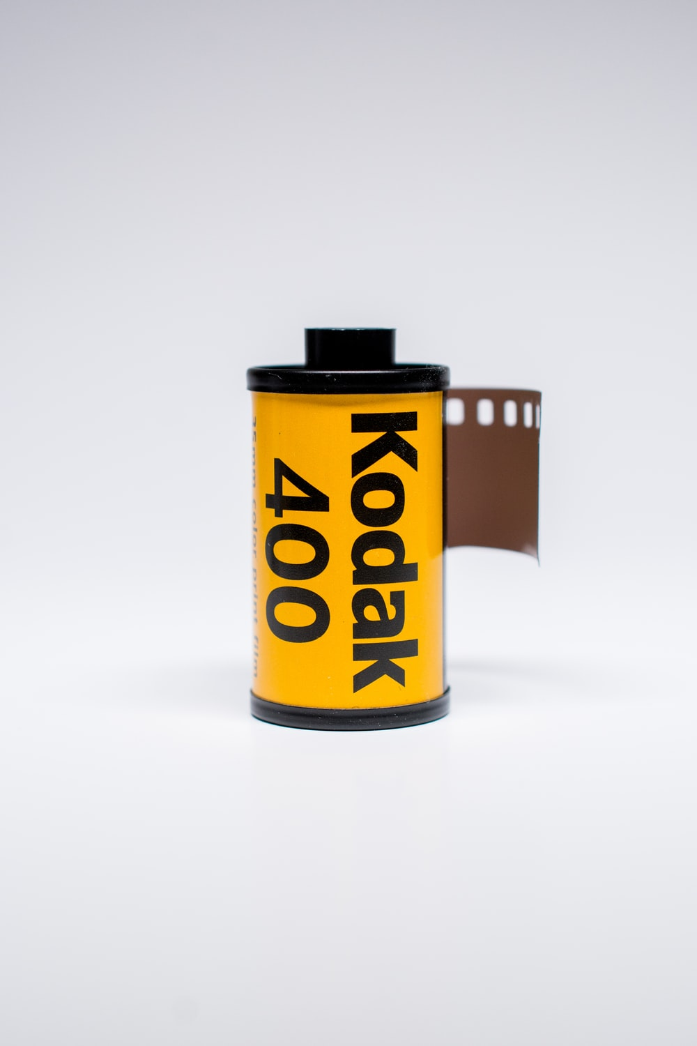 black and yellow can on white table