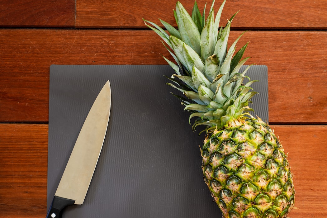 If you put a piece of pineapple somewhere in your mouth it will start eating you. It has proteins that degrade meat.