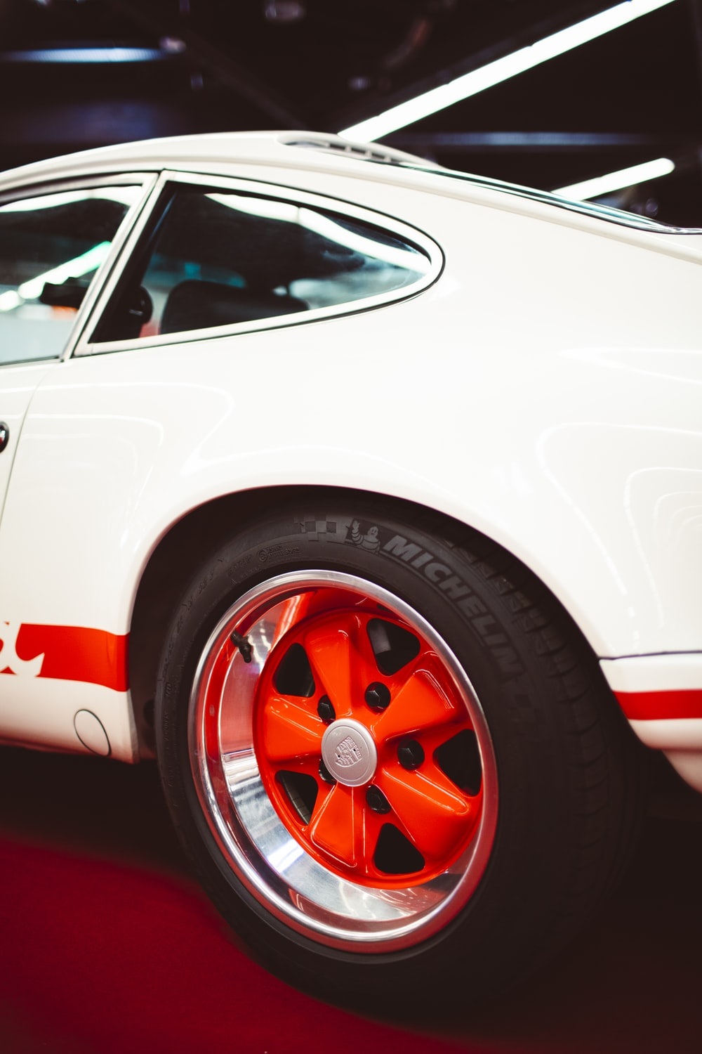 white and red car in close up photography