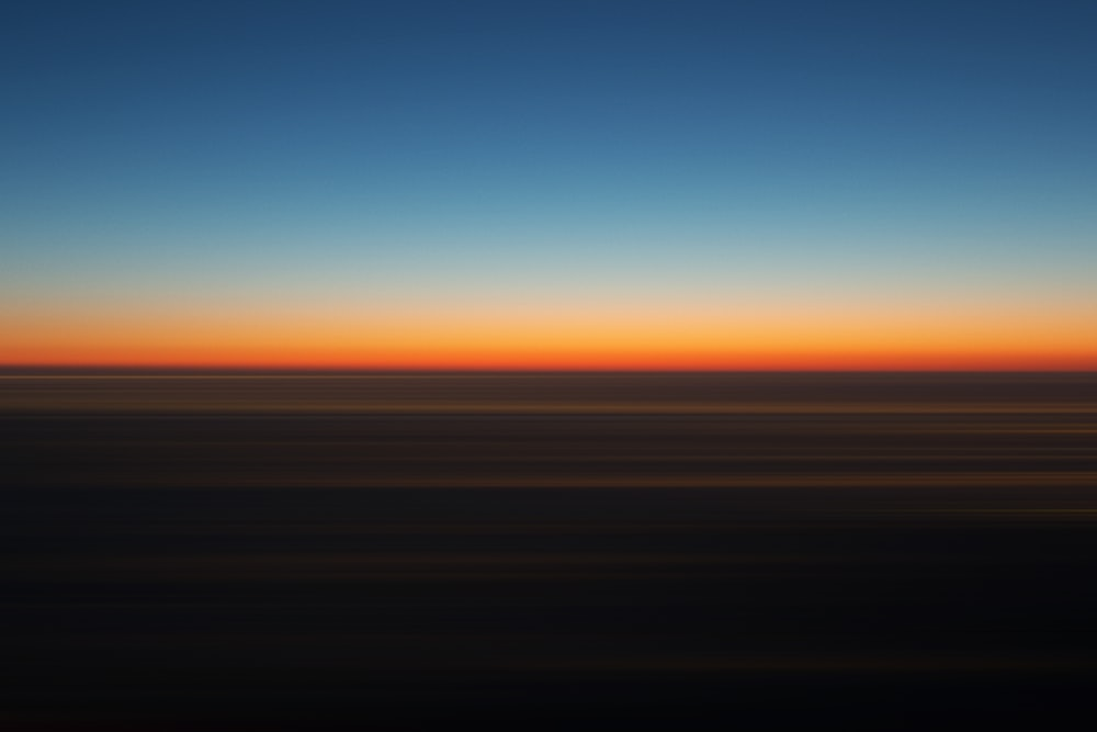 blue and orange sky during sunset