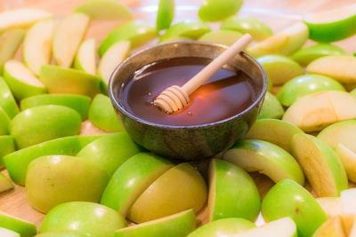 brown wooden spoon on green round fruit rosh hashana zoom background