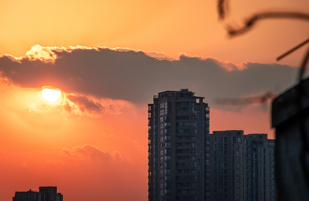 silhouette of high rise buildings during sunset