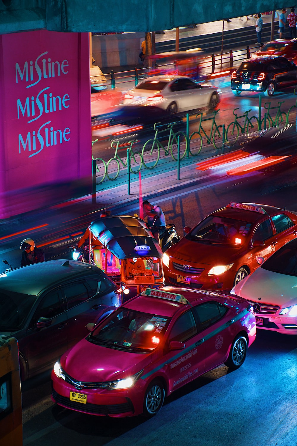 cars parked on parking lot during night time