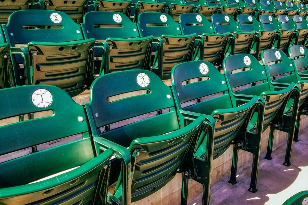 green and brown folding chairs