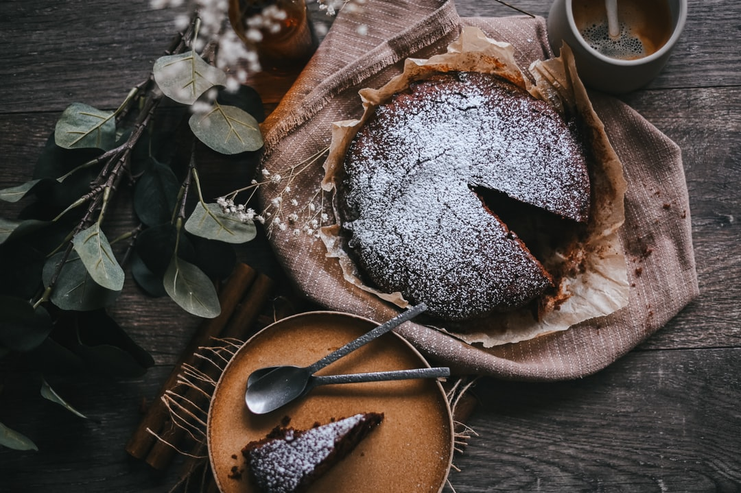 Brown and White Bread On Brown Wooden Round Plate - unsplash