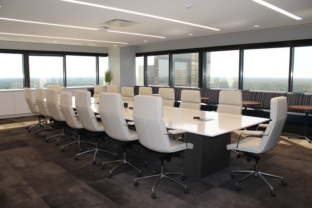 white and gray office rolling chairs
