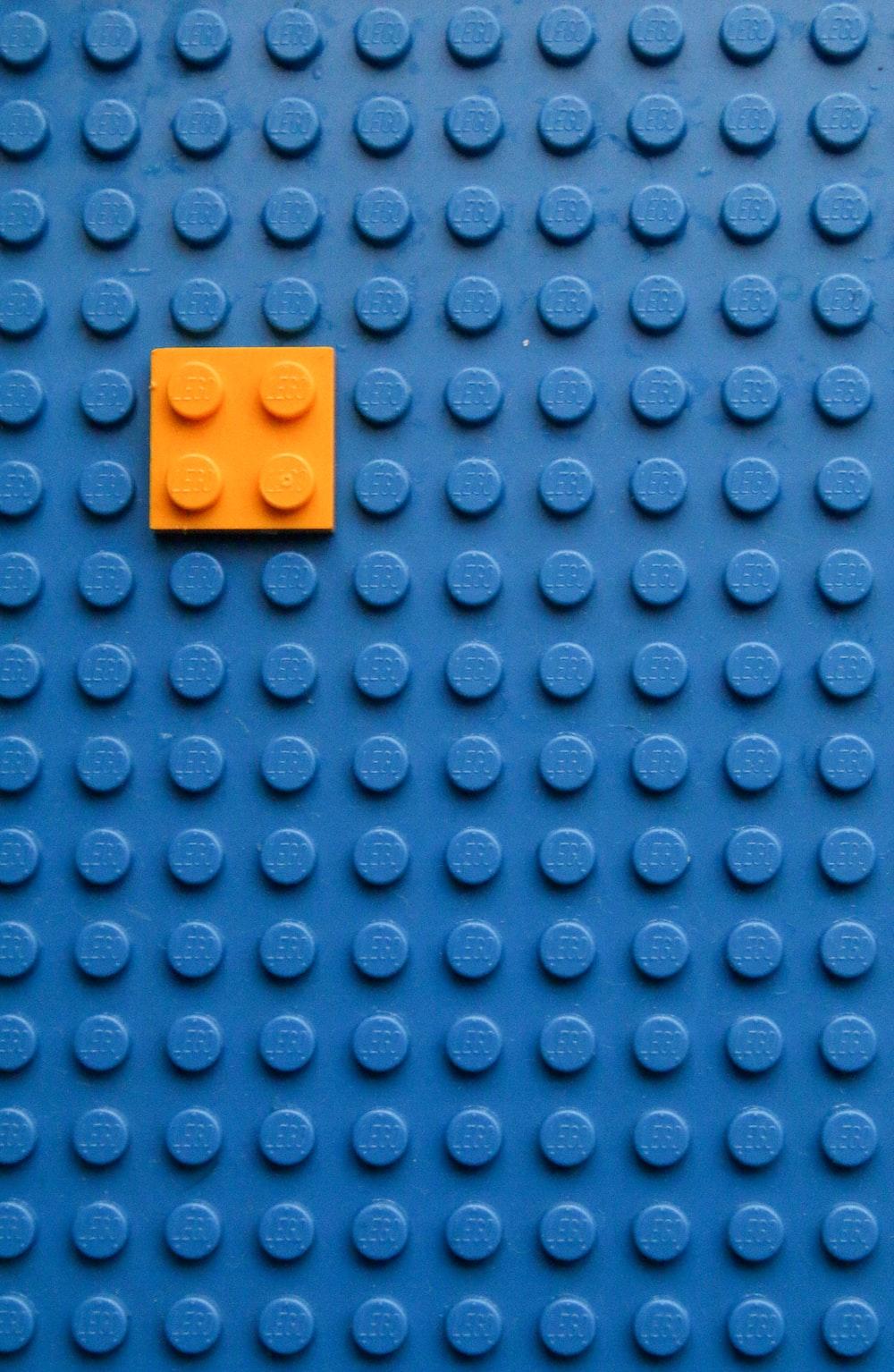 orange square on blue surface