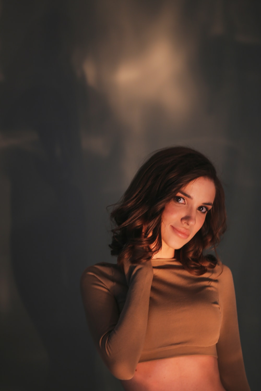 woman in brown turtleneck long sleeve shirt