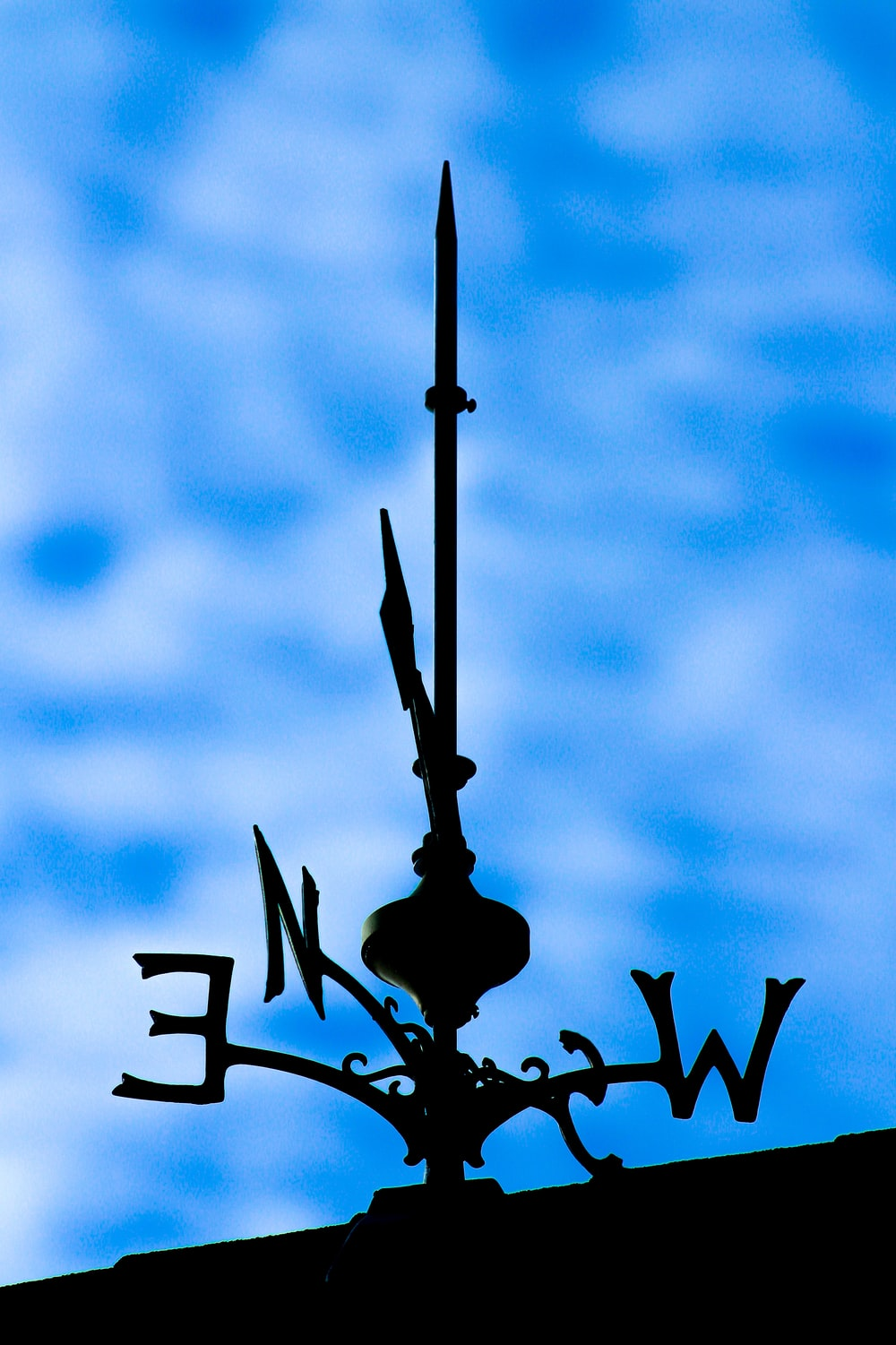 black metal lamp post under blue sky