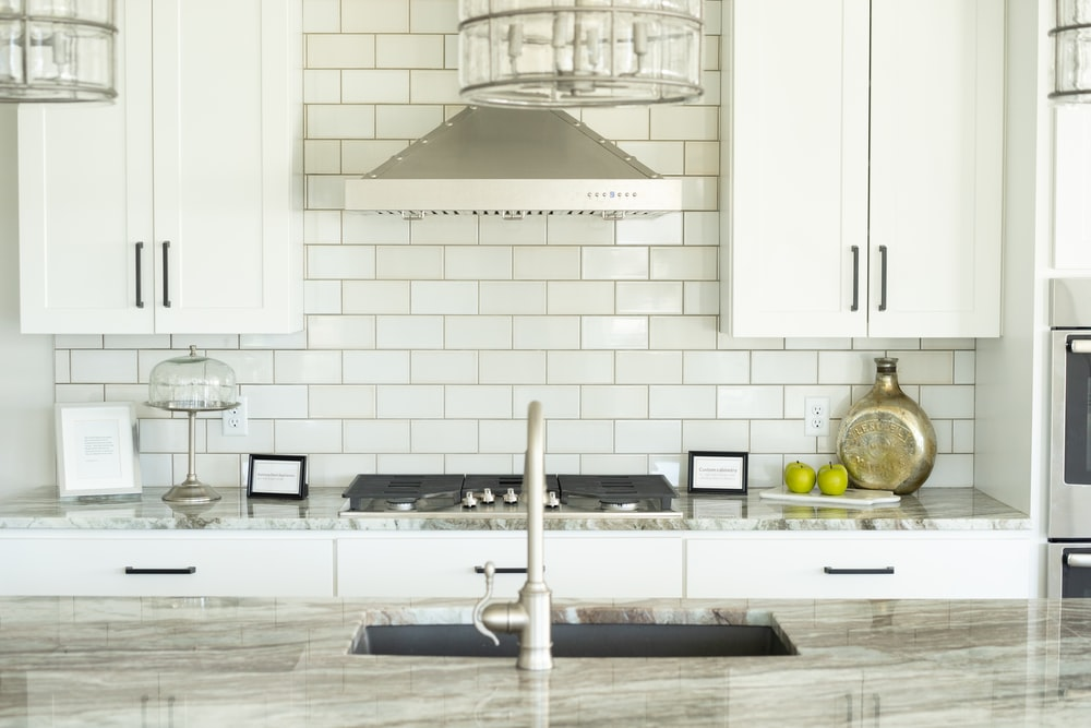 white and silver kitchen sink