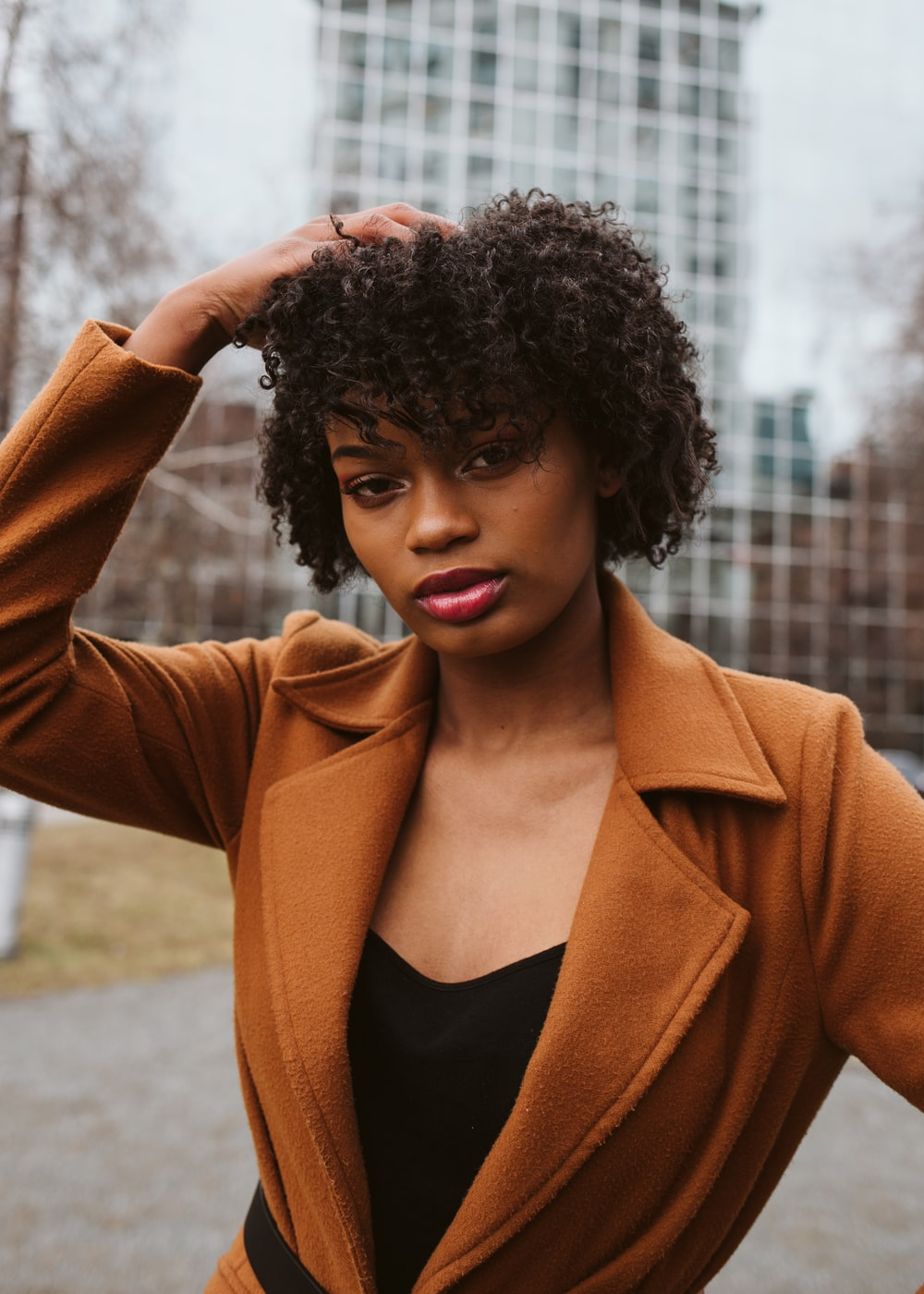 woman in brown blazer and black shirt