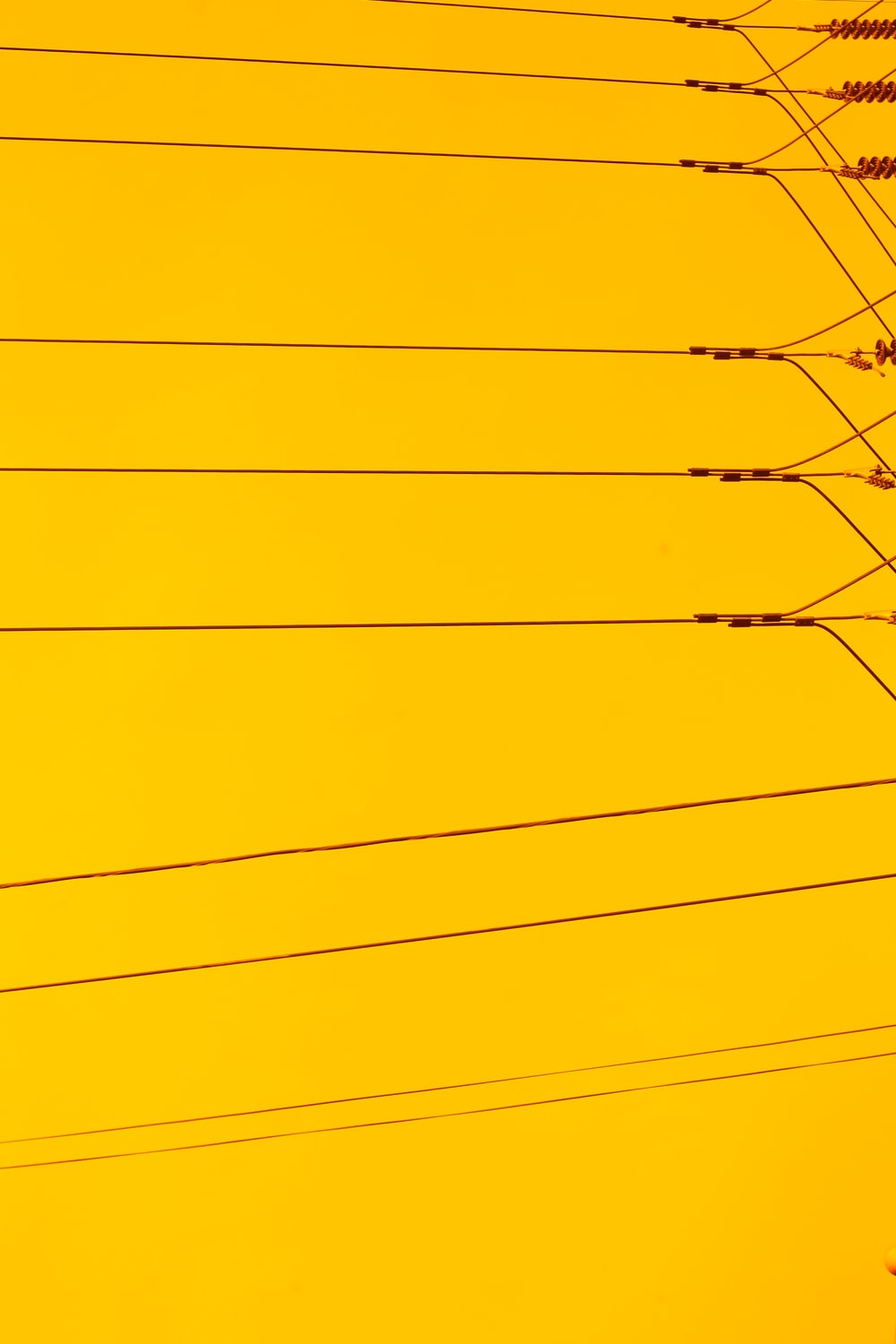 black electric wires under blue sky during daytime