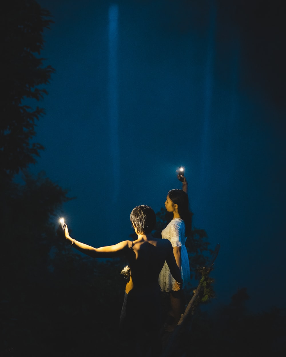 man and woman kissing during night time