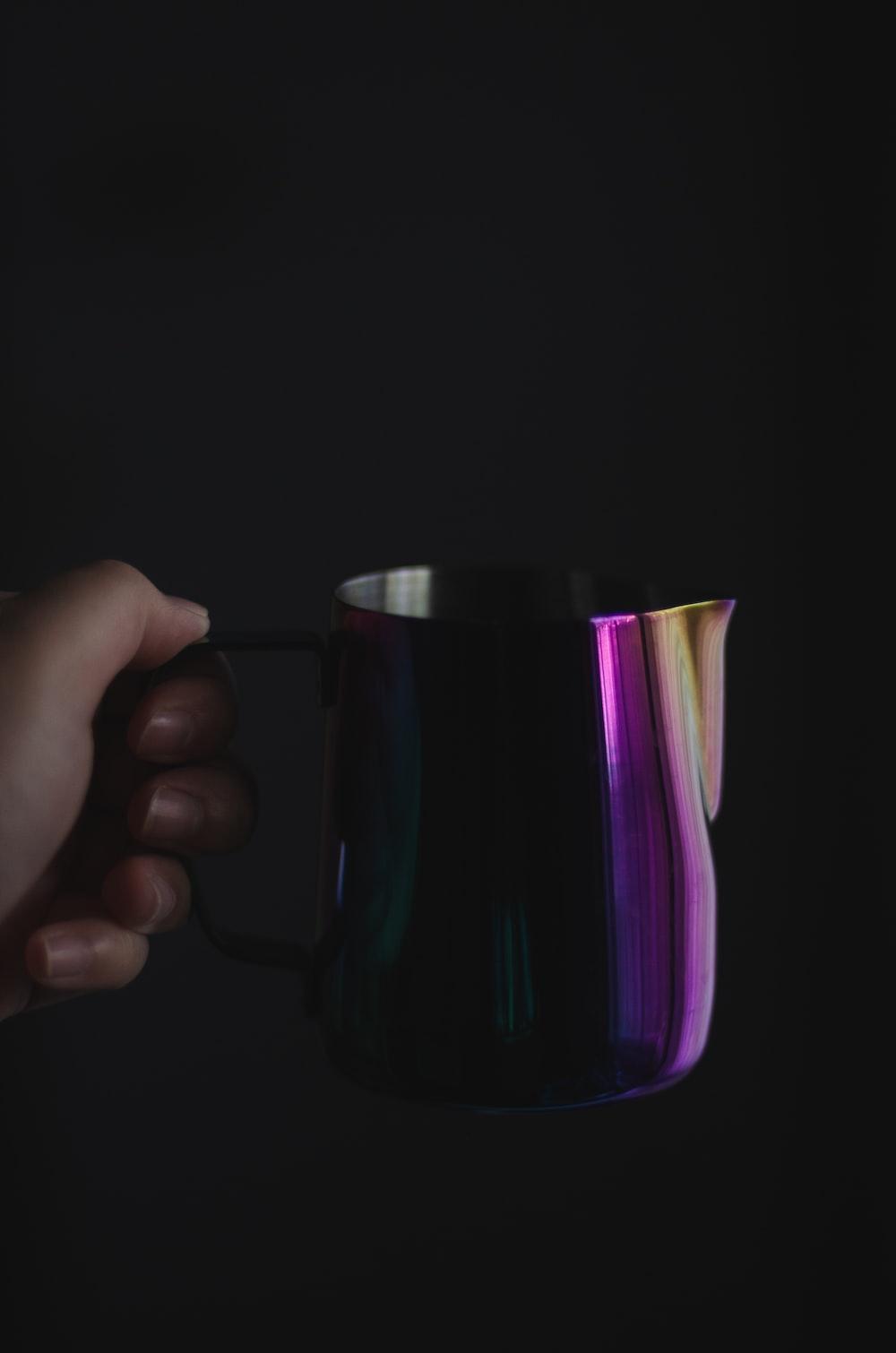 purple and black ceramic mug