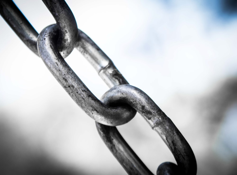 gray metal chain in close up photography