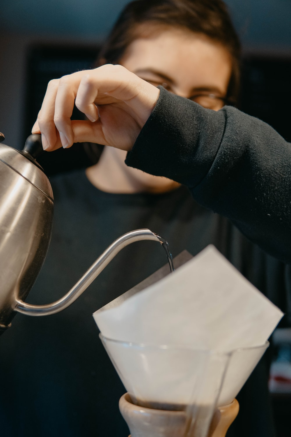 person holding stainless steel kettle