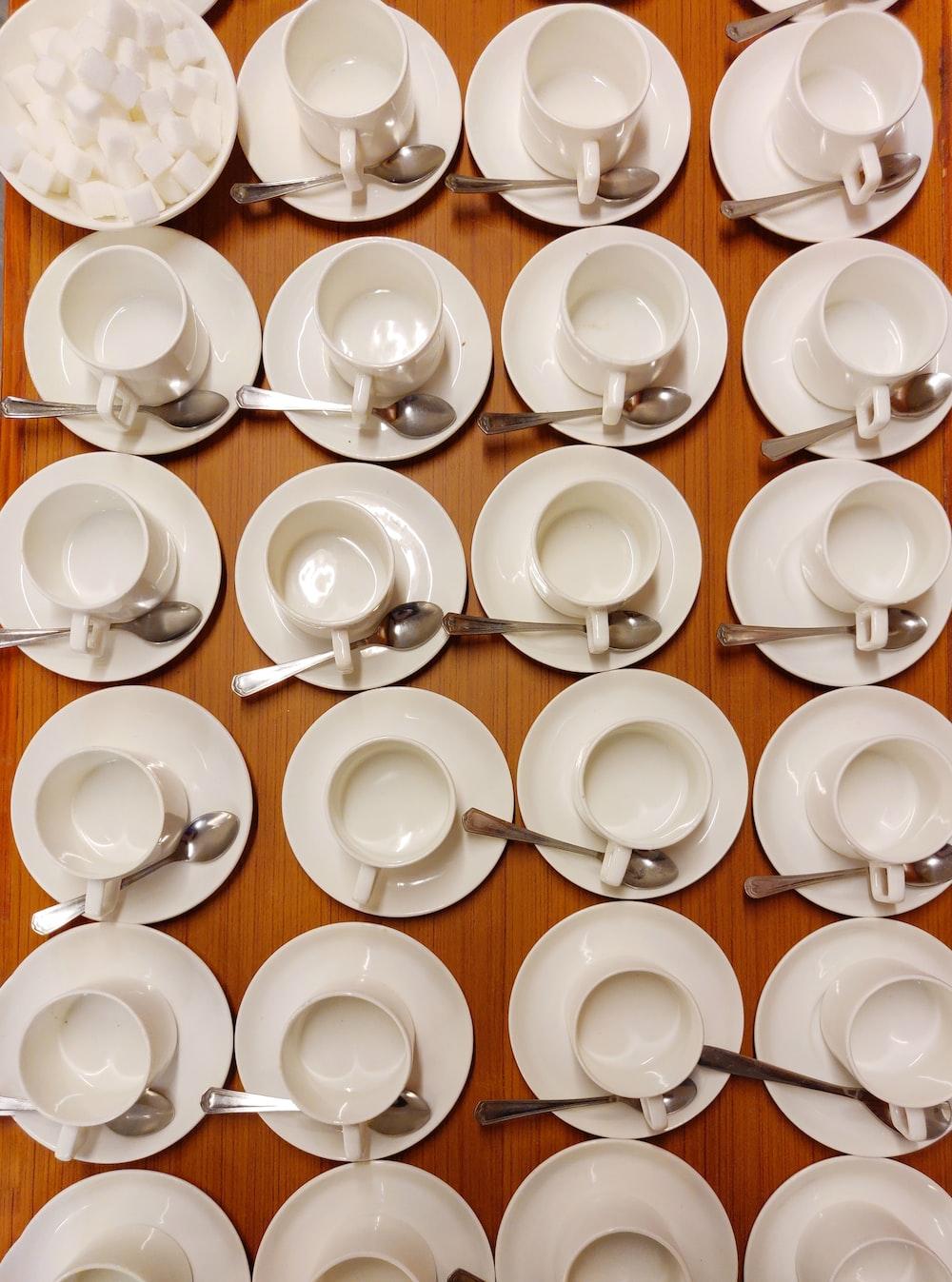 white ceramic teacup set on white ceramic saucer