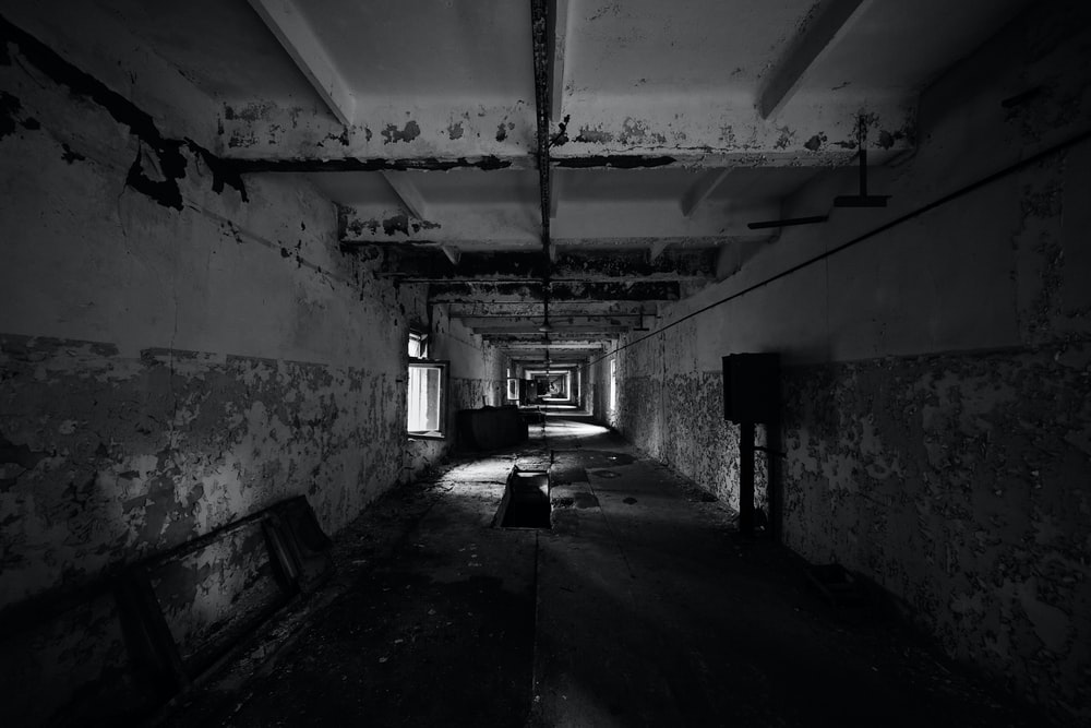 grayscale photo of abandoned building